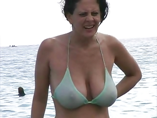 super lady into underwear at the shore
