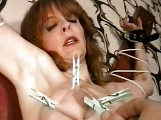 grownup slave punished with clothespins