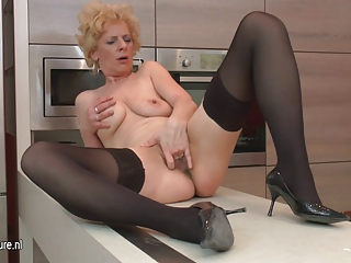 ugly cougar amp likes to masturbate into her