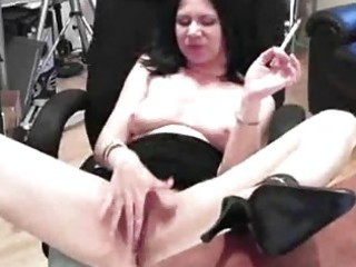 awesome cougar chick named mina strokes an fist