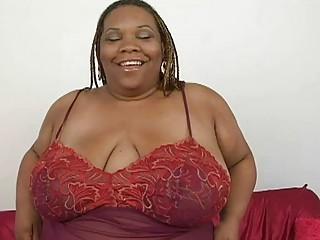 chubby dark momma with large bosom teases with
