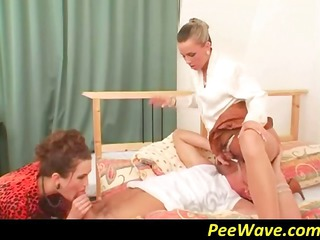 two hot woman are having a fine pissing period