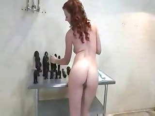nasty cougar redhaired stuffs and stretches her