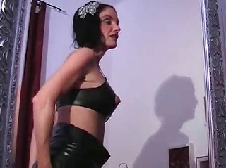 horny latex lady playing