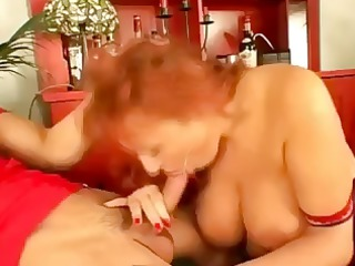 busty woman gets on two amateur boys and gives