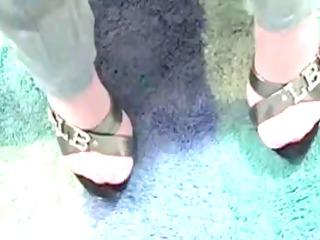 hot woman in pantyhose giving footjob