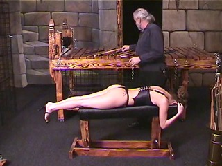 brunette inside leather bustier lies on bench for