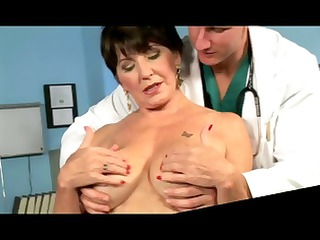 busty brunette granny chews on his knob and