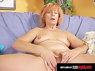 redheaded elderly uses a plastic cock