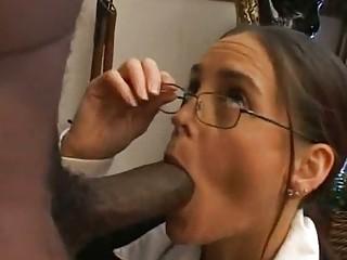 grownup professor eats a large brown snack