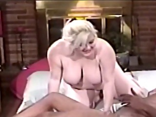 heavy lady blond blowing giant brown dick before