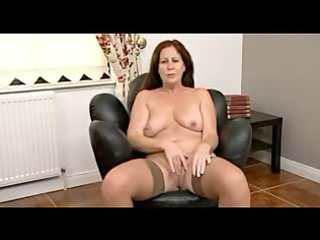 plump brunette mature undresses and shows her